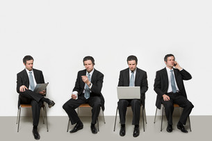 Businessmen with different objectsの写真素材 [FYI03467469]