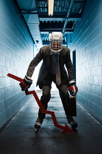 Businessman wearing an ice hockey uniformの写真素材 [FYI03468610]