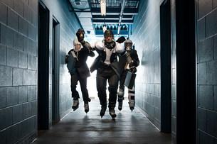 Three businessmen wearing ice hockey uniformsの写真素材 [FYI03468611]