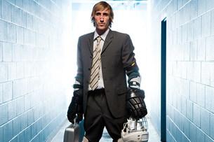 Businessman with an ice hockey uniformの写真素材 [FYI03468613]