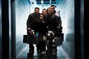 Five businessmen wearing ice hockey uniformsの写真素材 [FYI03468614]