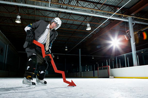 Businessman playing ice hockeyの写真素材 [FYI03468617]