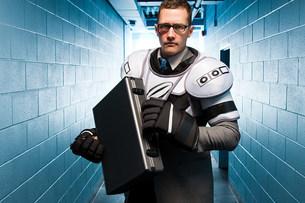 Businessman wearing ice hockey padsの写真素材 [FYI03468618]