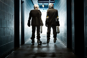 Two businessmen wearing ice hockey uniformsの写真素材 [FYI03468621]