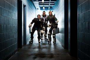 Three businessmen wearing ice hockey uniformsの写真素材 [FYI03468622]