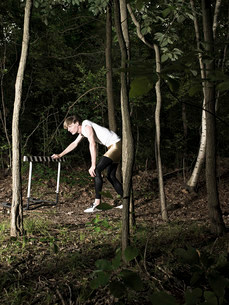 Athlete by hurdle in forestの写真素材 [FYI03468663]