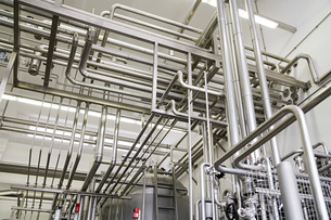 Industrial piping in a factoryの写真素材 [FYI03469255]