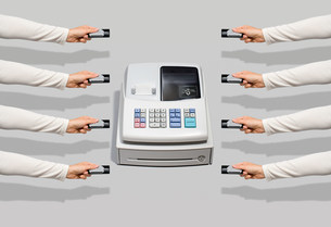 Cash register and people with credit cardsの写真素材 [FYI03470906]