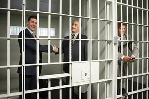 Businessmen in jailの写真素材 [FYI03471036]
