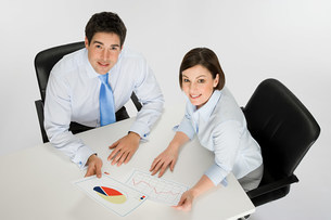 Colleagues with chart and graphの写真素材 [FYI03471198]