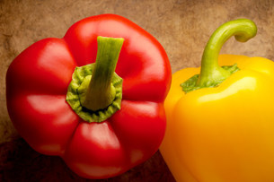 Two peppers on textured backgroundの写真素材 [FYI03471232]