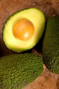 Avocados on textured backgroundの写真素材 [FYI03471233]