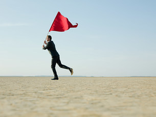 Businessman holding a red flagの写真素材 [FYI03471723]