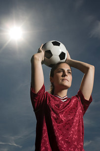 Woman holding footballの写真素材 [FYI03472520]