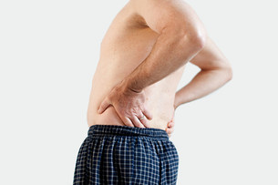 Man with back painの写真素材 [FYI03475148]