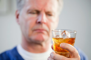 Man with glass of whiskyの写真素材 [FYI03475161]