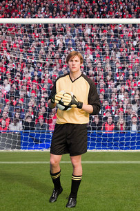 Goalkeeper holding footballの写真素材 [FYI03475961]