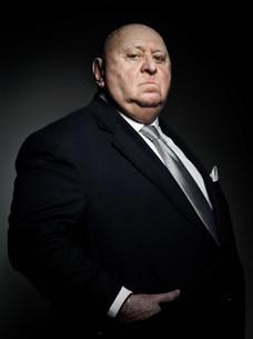 Studio portrait of serious gangsterの写真素材 [FYI03476048]