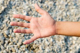Person's palm against textured backgroundの写真素材 [FYI03477402]