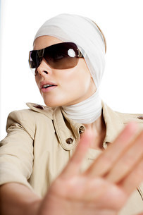 Young woman in sunglasses and bandages after cosmetic surgerの写真素材 [FYI03478143]