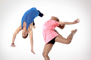 Man doing a somersault with woman jumpingの写真素材 [FYI03479516]
