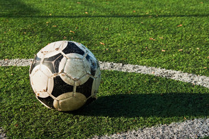 Close up of a ball on a football pitchの写真素材 [FYI03479627]