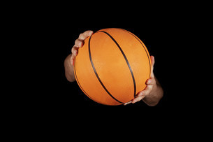 Close up of basket ball being heldの写真素材 [FYI03479629]