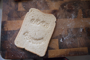 """""""Good morning"""" stamped into breadの写真素材 [FYI03479946]"""