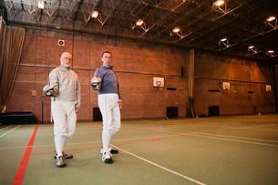 Senior and mature men fencing togetherの写真素材 [FYI03480518]