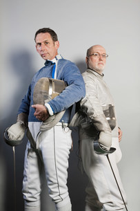 Senior and mature male fencers, portraitの写真素材 [FYI03480519]