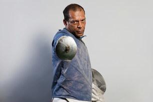Portrait of senior man in fencing suitの写真素材 [FYI03480523]