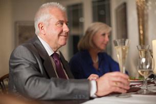 Senior man at celebration dinnerの写真素材 [FYI03480668]