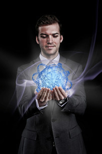 Man holding holographic information ballの写真素材 [FYI03481220]
