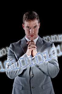 Businessman surrounded by ring of binary codeの写真素材 [FYI03481223]