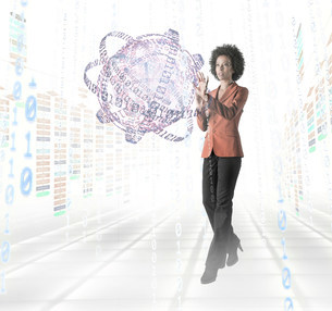 Businesswoman standing amidst digital objectsの写真素材 [FYI03481296]