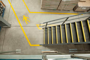 Steps and yellow lines in warehouse, elevated viewの写真素材 [FYI03482417]