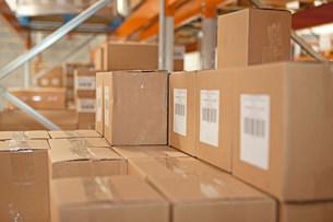 Cardboard boxes in warehouseの写真素材 [FYI03482421]