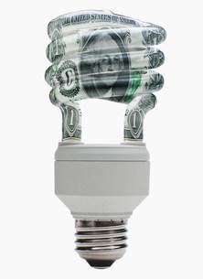 Energy saving lightbulb with dollar designの写真素材 [FYI03482432]