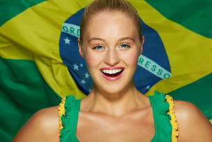 Young woman in front of Brazilian flagの写真素材 [FYI03482636]