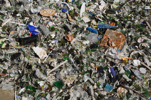Broken glass and other debris at waste management siteの写真素材 [FYI03483614]