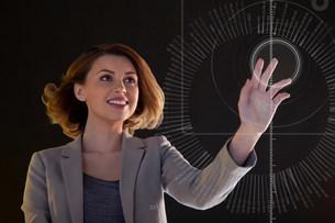 Businesswoman touching digital symbolの写真素材 [FYI03483757]