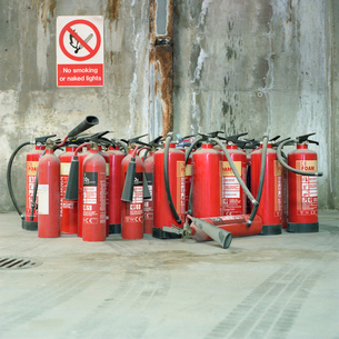 Fire extinguishers and no smoking signの写真素材 [FYI03491797]