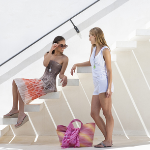 Trendy young woman talking on stairwayの写真素材 [FYI03491911]