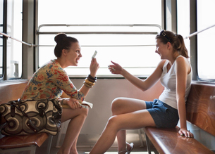 Women travelling in funicular trainの写真素材 [FYI03492672]