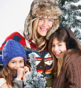 Mother and daughters beside snowy treesの写真素材 [FYI03493759]