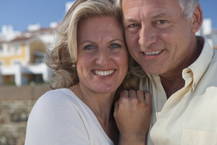 Mature couple by property developmentの写真素材 [FYI03494036]