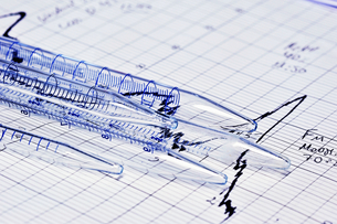 Close up of test tubes on graph in labの写真素材 [FYI03496156]