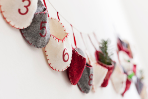 Close up of advent calendar on wallの写真素材 [FYI03496872]