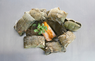 Tamales, wrapped in banana leavesの写真素材 [FYI03497713]