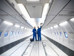 Worker examining empty airplaneの写真素材 [FYI03497839]